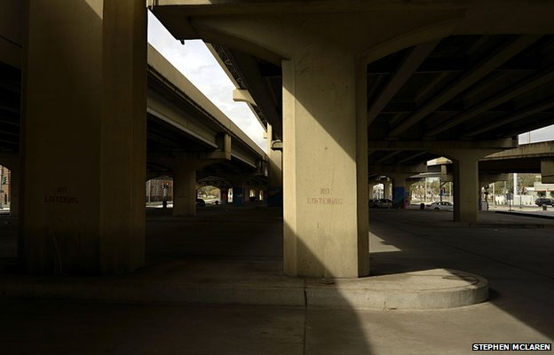 Underpass, no loitering sign