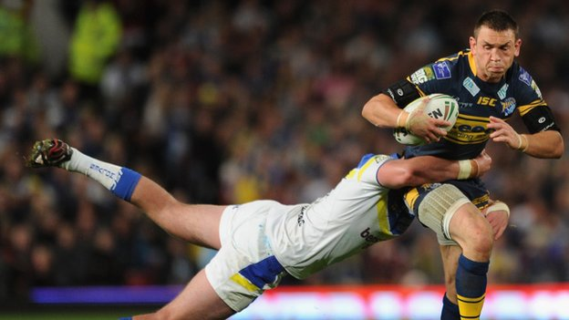 Kevin Sinfield is tackled by Trent Waterhouse