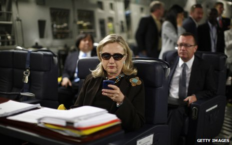 Clinton on her blackberry