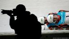 Canada's Tristan Walker and Justin Snith speed past a photographer