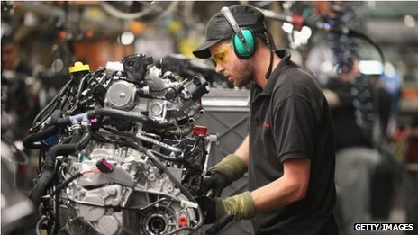 Technician works on a car engine at a Nissan factory in Sunderland