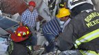 Firefighters and workers dig for survivors after the Pemex blast, 31 January 2013