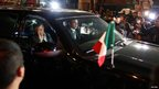 Mexico's President Enrique Pena Nieto (L inside car) waves to the crowd while arriving at the headquarters of state oil giant Pemex in Mexico City, 31 January 2013