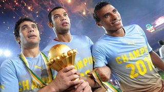 Egyptian players celebrate with the Nations Cup trophy in Luanda in 2010