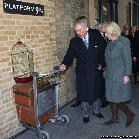 Prince Charles, Prince of Wales and Camilla, Duchess of Cornwall visit platform 9 3/4 at Kings Cross Rail Station