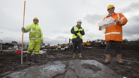 Annwyl Construction team at Croes Atti site, where Roman road slabs have been discovered