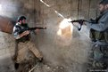 Fighters from the Free Syrian Army's Tahrir al Sham brigade fire back at Syrian army during heavy fighting in Mleha suburb of Damascus