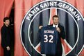 British football player David Beckham poses with his new Paris Saint-Germain (PSG) jersey