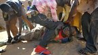A person accused of looting in Gao, Mali, is tied up by those who caught him - Wednesday 30 January 2013