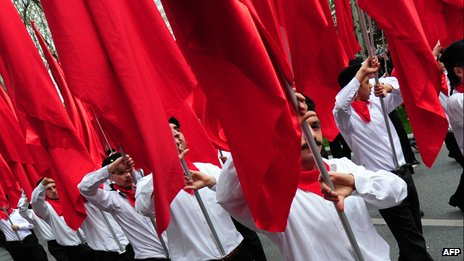 Protesters from outlawed leftist group DHKP-C march with red flags during a May Day rally in central Istanbul, on May 1, 2011