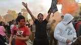 An Egyptian protester shouts slogans during a demonstration in opposition to President Mohammed Morsi in front of Cairo's Presidential palace on Friday.