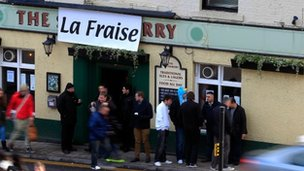 Newcastle fans outside The Strawberry pub