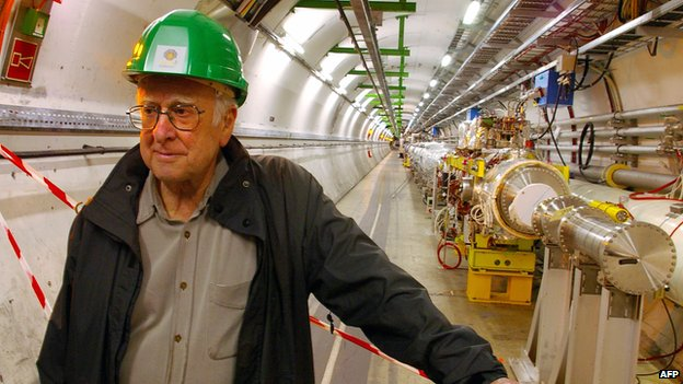 Prof Peter Higgs stands proudly beside the Large Hadron Collider