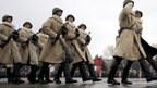 Troops wearing World War II-era winter clothes march in parade - 2 February