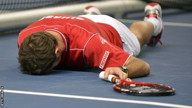 Stanislas Wawrinka has a lie-down during the epic Davis Cup match