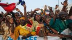 Malians cheer as Francois Hollande speaks at Independence Plaza in Bamako, Mali, 2 February 2013