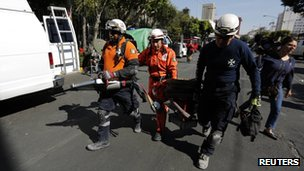 Rescue workers carrying equipment at the site of Thursday&#039;s blast in Mexico City