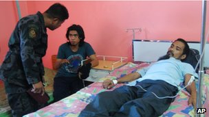 Roland Letriro, centre, and Ramel Vela, right, in hospital after their release
