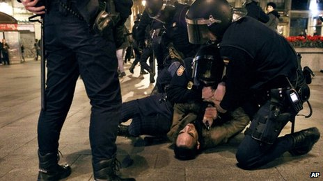 Police hold down a demonstrator in Madrid - 2 February