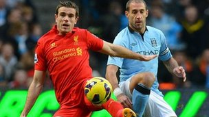 Liverpool's Jordan Henderson (left) and Manchester City's Pablo Zabaleta