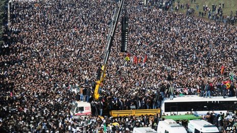 Thousands of Kurds gather to carry the coffins of the three top Kurdish activists Sakine Cansiz, Fidan Dogan and Leyla Soylemez, shot dead in the French capital, on January 17 in Diyarbakir.