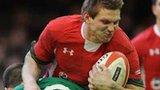 Dan Biggar is tackled by Ireland's Jonathan Sexton