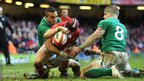 Leigh Halfpenny wriggles over in the corner as Wales begin a fight-back against Ireland