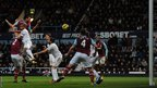 Andy Carroll, making his first start since November, heads home to secure the victory for West Ham over Swansea.