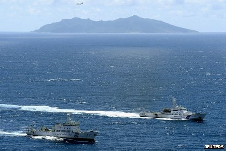 An aerial photo shows the Chinese marine surveillance ship Haijian No. 51 (L) cruising as a Japan Coast Guard ship Ishigaki sails near Uotsuri island, one of the disputed islands, called Senkaku in Japan and Diaoyu in China, in the East China Sea in this file photograph from 14 September 2012