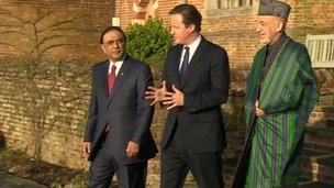 David Cameron (C) with Afghan President Hamid Karzai (R) and Pakistani President Asif Ali Zardari at Chequers, north of London, 4 Feb