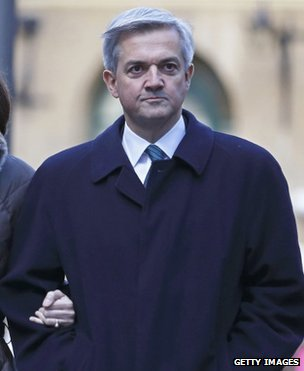 Chris Huhne arriving at court