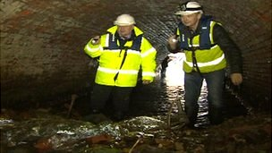 Chris Jackson inside a culvert blocked in recent floods