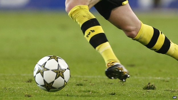 Footballer kicking a ball