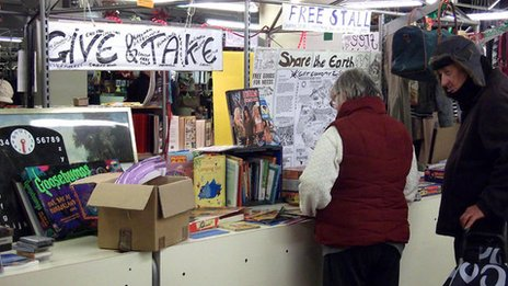 Customers browsing at the Give and Take stall