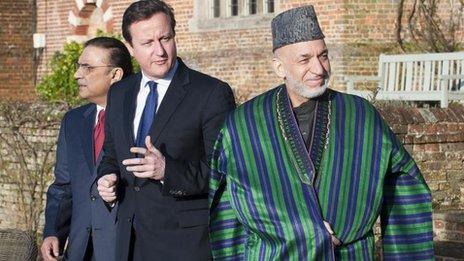 Prime Minister David Cameron (centre) with President Hamid Karzai (right) and President Asif Ali Zardari of Pakistan (left)