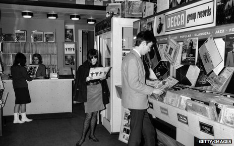 60s teenagers in a record shop