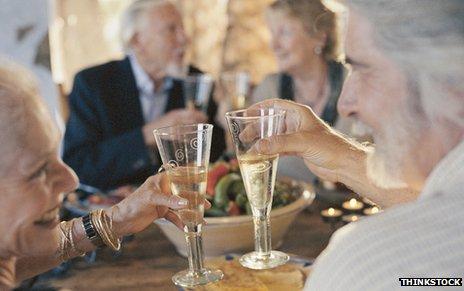 Fiftysomethings drinking champagne