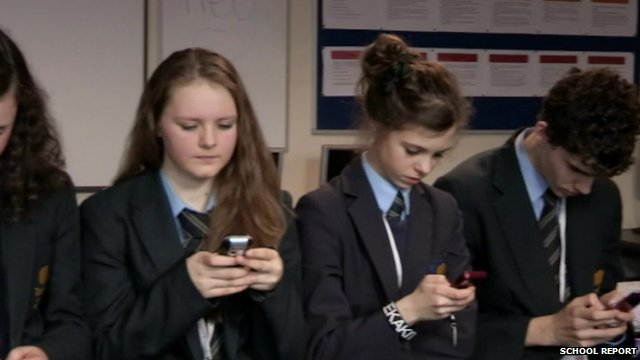 Pupils use their phones to check Twitter