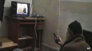Bin Laden watches TV in Abbottabad