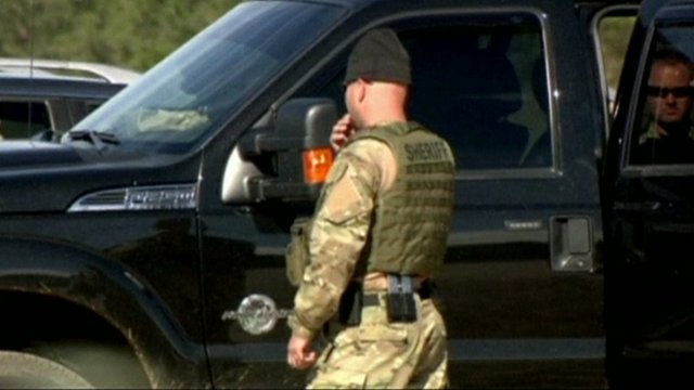 Sheriff in camouflage clothing at the site of the hostage