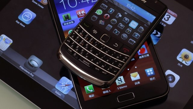 A Blackberry Bold smartphone, a Samsung Galaxy Note phablet, and an Apple iPad 2