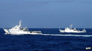 Japan's coast guard ship (left) sails along China's marine surveillance near the disputed islands in the East China Sea. File photo