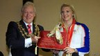 Rebecca Adlington is given gold Jimmy Choo shoes by Mayor Tony Eggington in her hometown of Mansfield