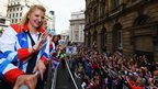 Rebecca Adlington waves to the crowd during the London 2012 victory parade