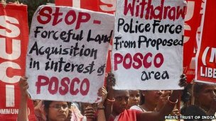 Anti-Posco activists hold up placards during a protest in Orissa