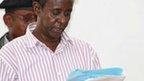 Mogadishu court judge Ahmed Aden Farah reads the verdict inside a court in Mogadishu on 5 February 2013
