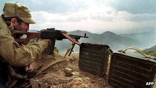 Armenian soldier aims his weapon at the frontline near the town of Hadrut, Nagorny Karabakh, in April 1993