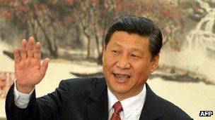 Xi Jinping emerges as head of the Politburo Standing Committee of the Communist Party - and the new leader of the country - at the Great Hall of the People in Beijing on 15 November 2012