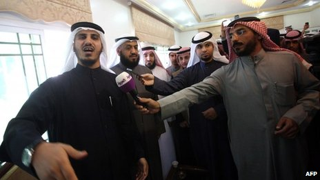 Former Kuwaiti MPs Bader al-Dahoum (Left) and Falah al-Sawwagh (2nd Left) stand with supporters before hearing the verdict (5 February 2013)