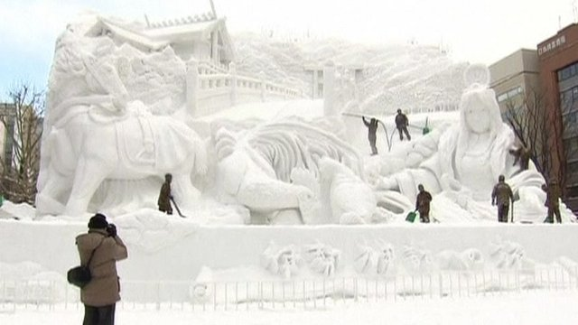 Visitors taking pictures at Sapporo Snow Festival